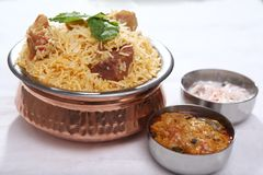 Mutton biryani, Indian Mutton Rice dish. Mutton biryani, a world-renowned Indian dish, is a mutton and rice dish traditional to Indian cuisine. The dish usually royalty free stock image