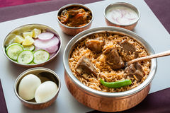 Mutton biryani with traditional sides Royalty Free Stock Images