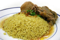 Mutton Briyani. Succulent mutton chunks with yellow colored bryani rice Stock Photos