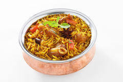 Mutton Briyani. A hearty mutton biryani that will amaze your guests! Layers of mutton and saffron-milk infused rice cooked 'dum' style. ... To the mutton add the Stock Photography