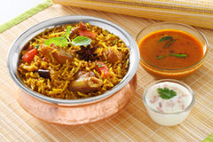 Mutton Briyani. A hearty mutton biryani that will amaze your guests! Layers of mutton and saffron-milk infused rice cooked 'dum' style. ... To the mutton add the Royalty Free Stock Photography