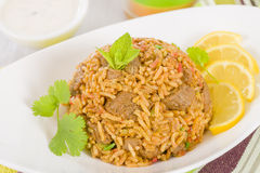 Mutton Byriani. Lamb and rice cooked with spices. Served with raita. Traditional South Asian Cuisine Royalty Free Stock Image