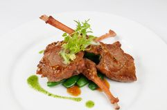 Mutton chop. On white dish royalty free stock photography