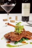Mutton chop. On white dish stock photography
