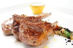 Mutton chop. On white dish stock images
