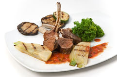 Mutton Chops. With vegetables on white plate stock images