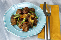 Mutton fry. On a plate on grey background stock image