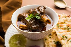 Mutton Masala Or Masala Gosht or indian lamb rogan josh. With some seasoning, served with Naan or Roti, selective focus Stock Image