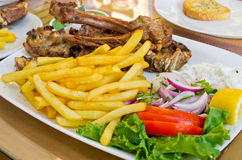 Mutton meat and french fries. Tasty mutton meat and french fries Royalty Free Stock Photos
