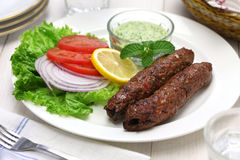 Mutton seekh kabab. With mint chutney royalty free stock image