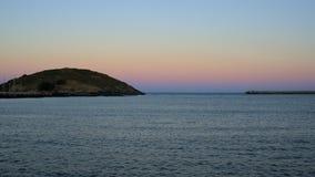 Muttonbirdeiland onder avondhemel Stock Foto