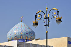 Muttrah Muscat decorated street lamp with dome of mosque beyond Royalty Free Stock Photo