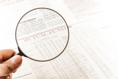 Mutual fund and magnifying glass Stock Photos