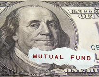 Mutual fund. Text on a paper scrap over one hundred dollar on foreground Royalty Free Stock Photos