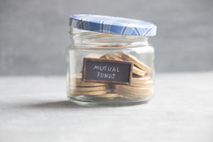 MUTUAL FUNDS idea - text and coins Stock Images
