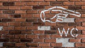 Muur dat richtingssymbool heeft Royalty-vrije Stock Afbeelding