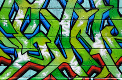 Muur die in kleurrijke graffiti wordt behandeld Royalty-vrije Stock Afbeeldingen