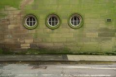 Muur met drie vensters Royalty-vrije Stock Afbeeldingen
