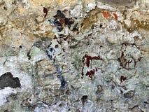 Muur met een oud pleister als grungy achtergrond Stock Afbeelding