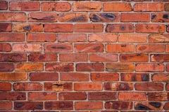 Muur met gebrande bakstenen Stock Foto