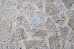 Muur met gespannen rotsenachtergrond stock afbeelding