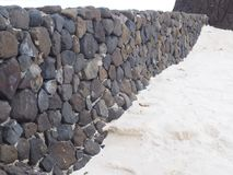 Muur op strand stock foto