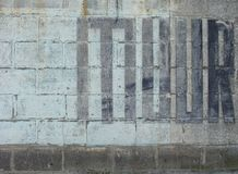 Muur, significando a parede no dutch pintado no preto Foto de Stock Royalty Free