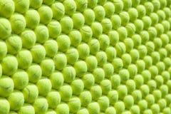 Muur van gerichte tennisballen - achtergrond Stock Afbeelding