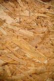 Muur van houten vlokkenhoogtepunt van textuur en willekeurig patroon Stock Afbeelding