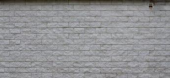 Muur van lichte die textuurtegels, in verschijning als baksteen wordt gestileerd Één van de soorten muurdecoratio royalty-vrije stock afbeeldingen