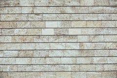 Muur van lichtgele decoratieve steen abstracte achtergrond stock afbeeldingen