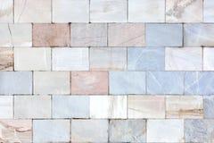 Muur van marmer Ongebruikelijke steentextuur Achtergrond van tegels Royalty-vrije Stock Fotografie