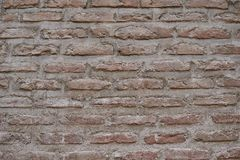 Muur van oude bruine bakstenen abstracte achtergrond Royalty-vrije Stock Afbeelding