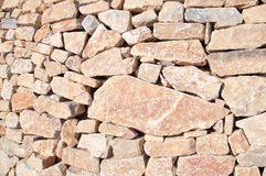 Muur van rode rotsen Stock Afbeeldingen