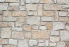 Muurbouw van natuurlijke zandstenen, lichtgrijs en beige Stock Fotografie