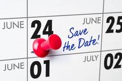 Muurkalender met een rode speld - 24 Juni Royalty-vrije Stock Afbeeldingen