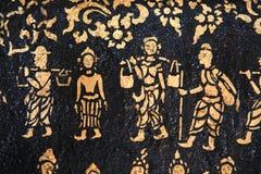 Muurschilderij bij de boeddhistische tempel van Wat Xieng Thong stock foto
