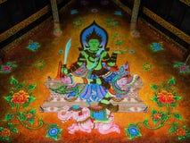 Muurschilderij van Godszitting over Olifant Stock Fotografie