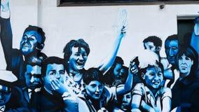 Muurschilderingtoejuichingen! stock foto