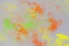 Muurtextuur met oranje groene gele rook, Abstracte achtergrond Royalty-vrije Stock Afbeeldingen