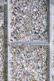 Muurtextuur van kleine stenen Stock Foto