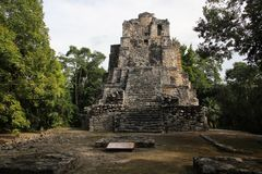 Muyil ancient Maya site, Mexico. Muyil was one of the earliest and longest inhabited ancient Maya sites on the eastern coast of the Yucatan Peninsula. It is stock photos