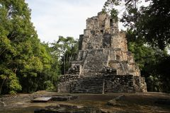 Muyil ancient Maya site, Mexico. Muyil was one of the earliest and longest inhabited ancient Maya sites on the eastern coast of the Yucatan Peninsula. It is royalty free stock photo
