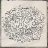 Muziekhand het van letters voorzien en krabbelselementen Stock Foto