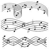 Muzieknota's over staaf Stock Fotografie