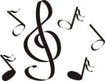 Muzieknoten een drievoud Stock Foto's