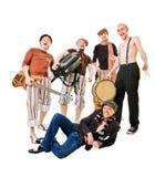Muzikale band met hun instrumenten op wit royalty-vrije stock afbeelding