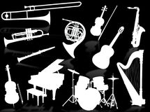Muzikale instrumentensilhouetten Royalty-vrije Stock Foto