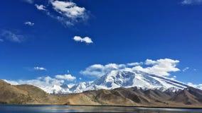 Muztagata Mountain and Karakuri Lake stock image