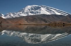 Muztagh Ata and Karakul Lake Stock Photography